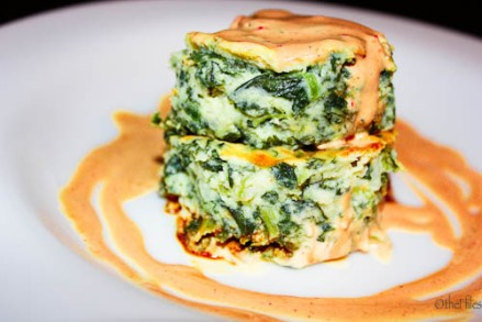 A cheesy, spinach soufflé covered in a tangy hollandaise sauce.